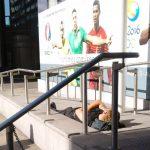 man-sunbathing-on-dublin-street